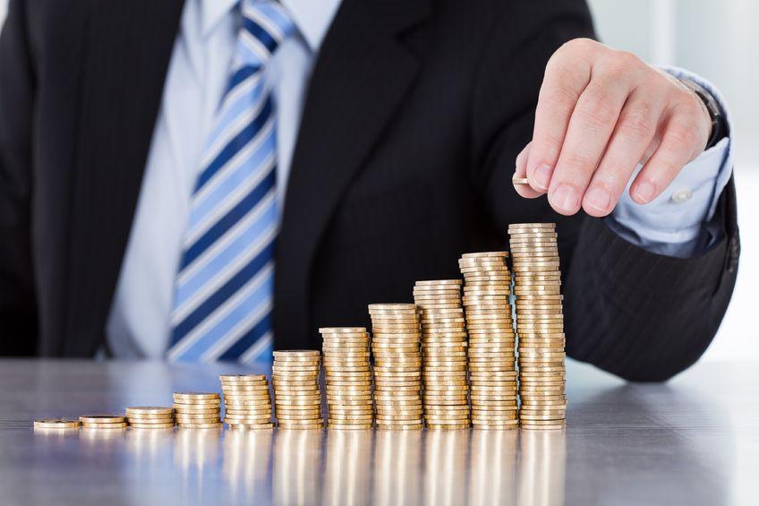 dca-businessman-coins-stack