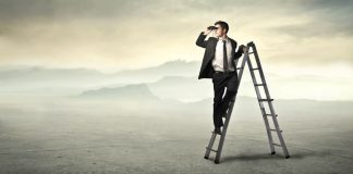 businessman-ladder-using-binoculars-desert
