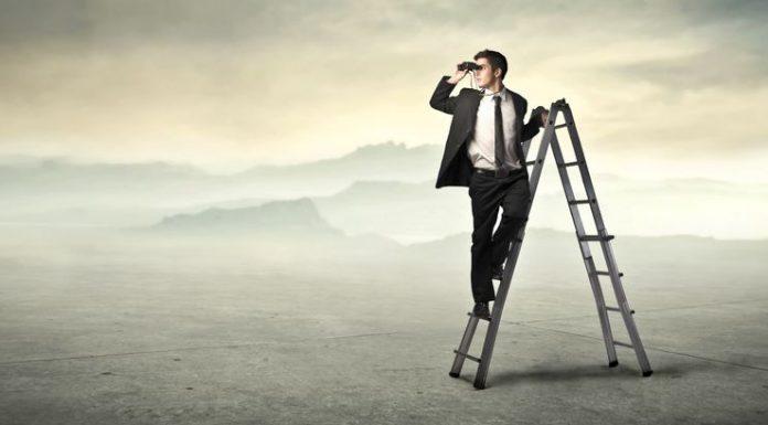 businessman-ladder-using-binoculars-desert