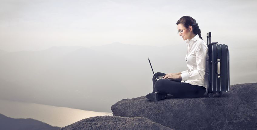 businesswoman-sitting-on-rock